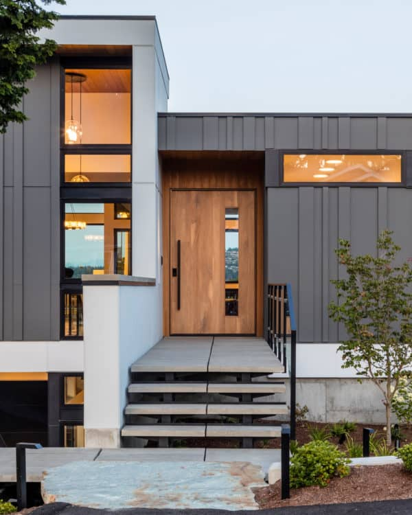 perfect the minimalist design by combining concrete front steps with wood and metal elements