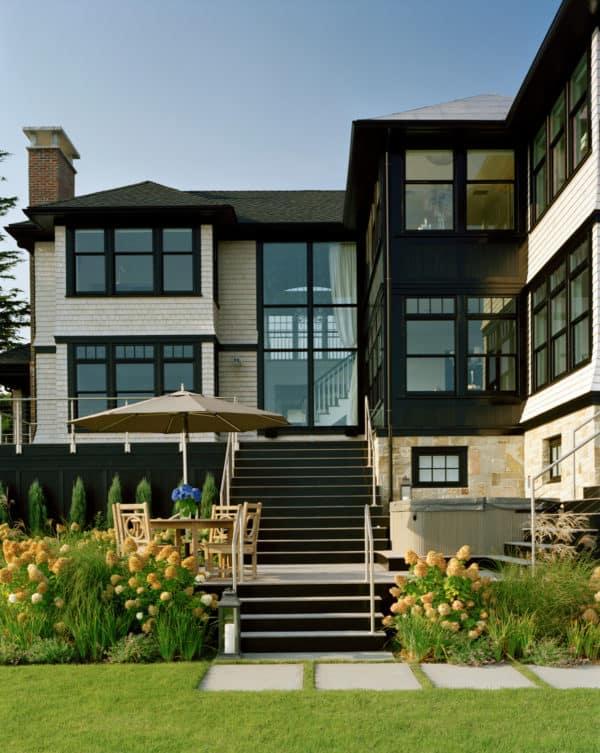 victorian dark wood windows in a lovely white cedar house