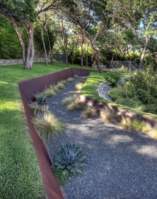 industrial retaining wall featuring corten steel to create a cool and secluded pathway