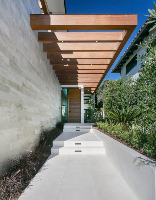these concrete front steps and walkway showcases a dramatic design idea with unique vibrancy