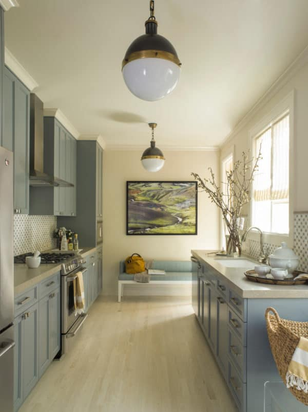 contemporary yet homey kitchen with blue cabinets and pale-yellow walls