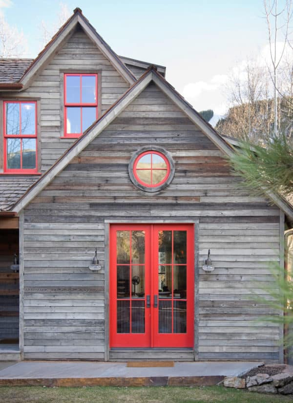 pair trendy red doors with reclaimed lumber exterior for a rustic retreat style house