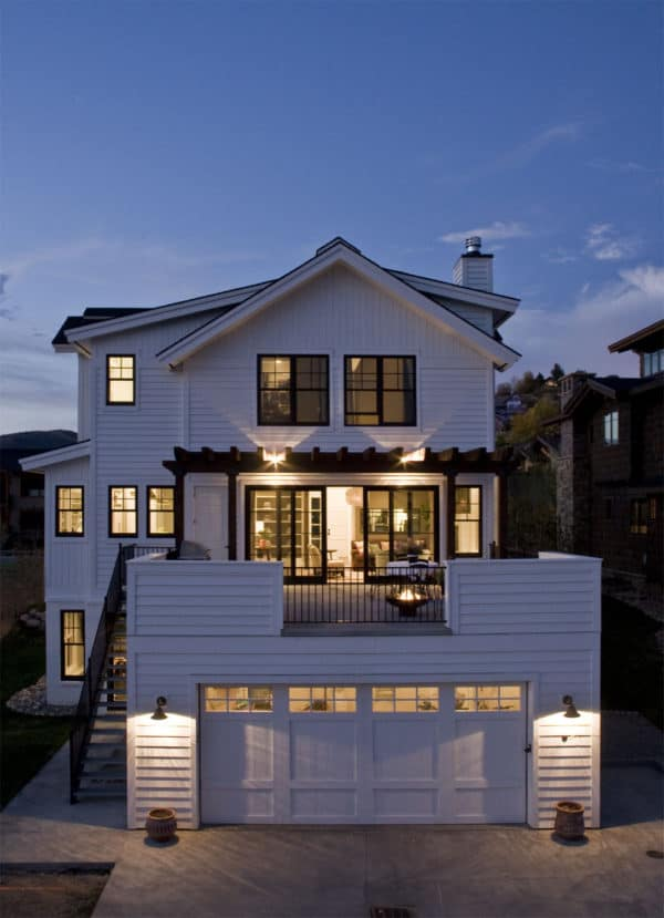 old town white farm house with black clad wood windows