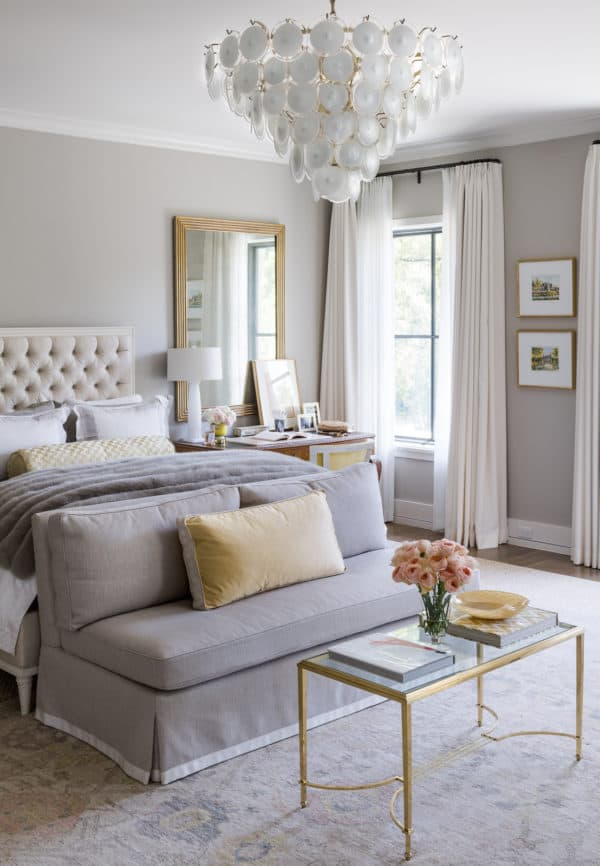 stunning master bedroom with white headboard and touches of gold