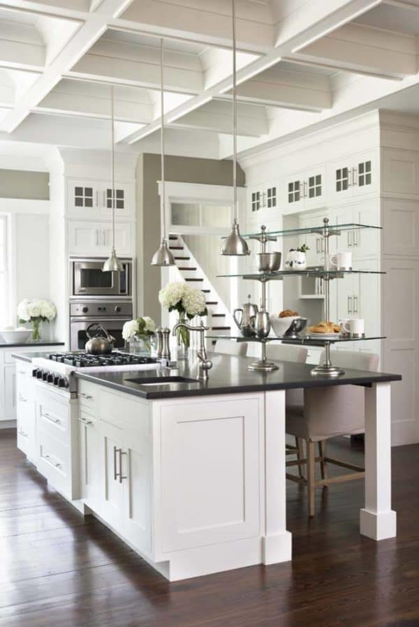 stainless appliances and installations create a theatrical look in this white country kitchen