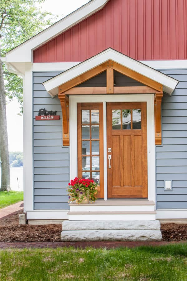 pair a traditional roof over door entry with colourful vinyl siding for a quirky vintage look