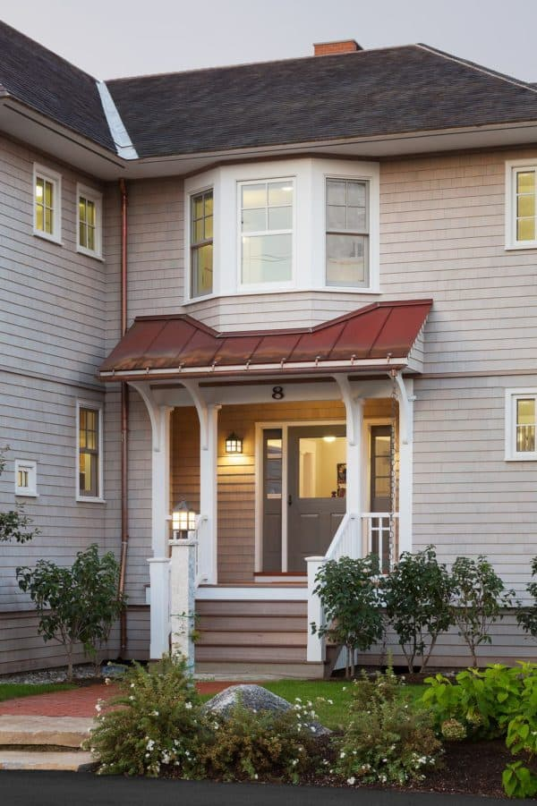 use real copper for roof over door entry in this victorian-inspired cottage home