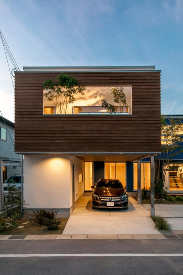 integrating carport with the house structure for stunning japanese-inspired architecture