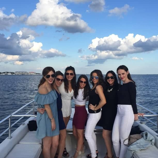 Group of women dressed up on the boat. Charleston bachelorette party boat