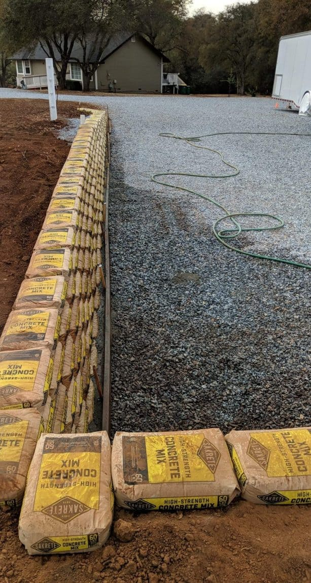 the process of building a driveway retaining wall from Sakrete bags
