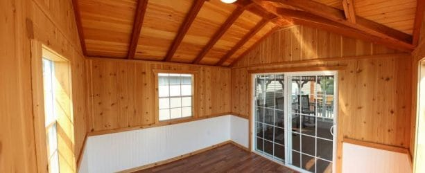 a pool house with cedar tongue and groove roof deck