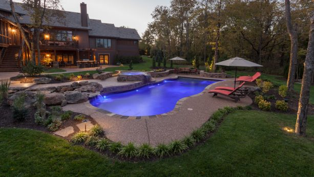 the same exposed aggregate floor also surrounds the pool together with some other flooring materials