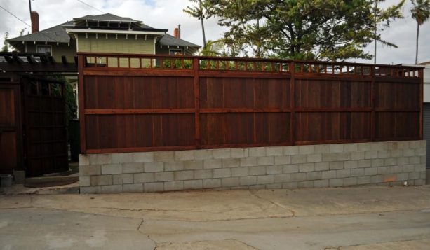 cinder block base for a wooden fence