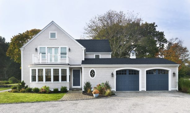 a traditional exterior with Benjamin Moore Newburyport Blue front and garage doors
