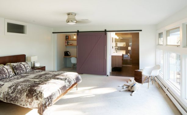 a sliding barn door that can cover a bathroom and a home office