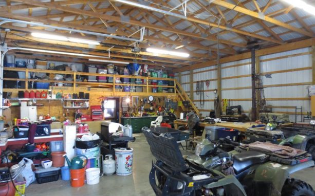 the interior of the pole barn workshop comes with loft at the back that adds more storage there