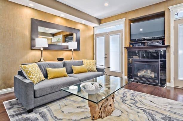 contemporary grey and yellow living room with yellow dandelion wall