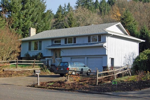 the old split-level house looks messy and uninviting