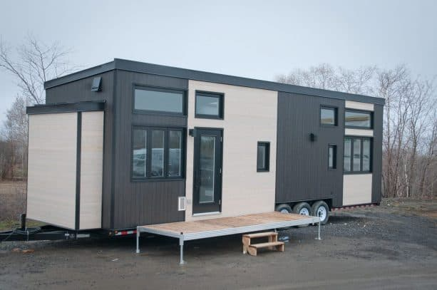 the exterior of this Magnolia XL tiny house does not show that it has a roof deck