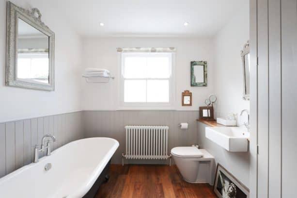 grey and white bathroom with hardwood floor