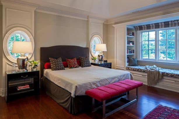 grey bedroom with red bed-end bench