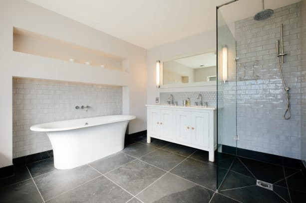 white bathroom with classic-looking grey stone tile flooring