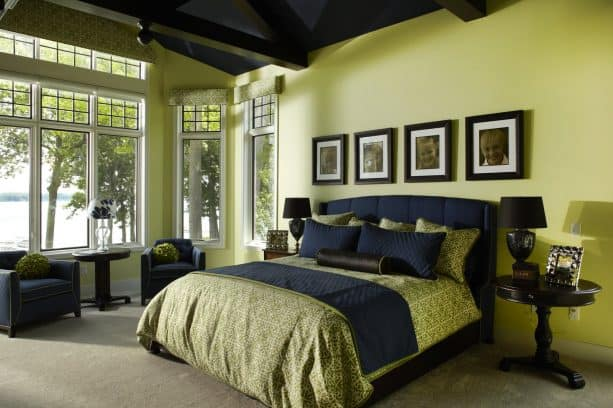 a traditional bedroom with green and navy theme