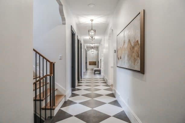 black and white porcelain checkered floor in a hall