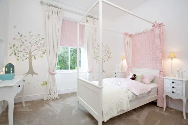 elegant white curtains with tiers and pink shade to treat a short wide kids bedroom window