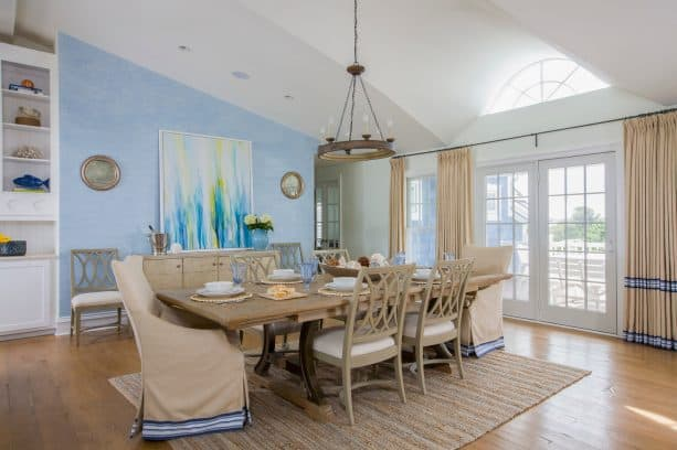 sky blue and white walls and linen white curtains in a beach-style dining room
