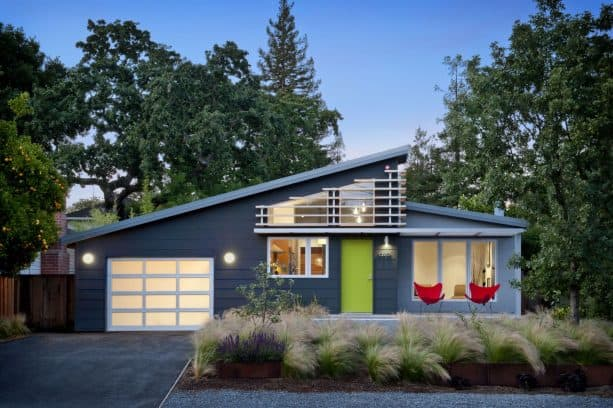 a midcentury exterior home design with dark grey color and white trim