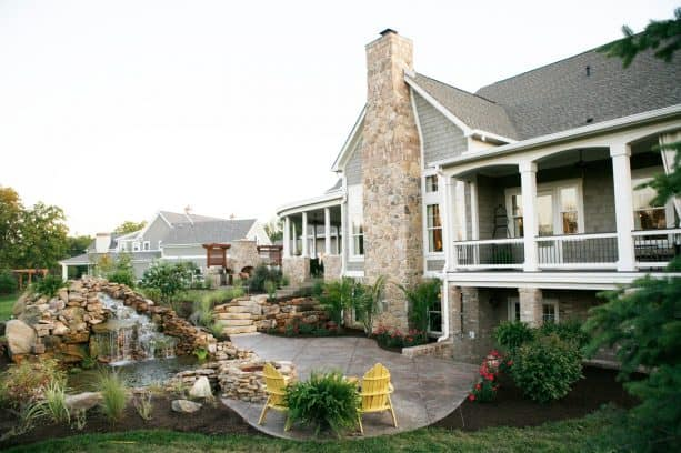 a traditional walkout basement patio with pond
