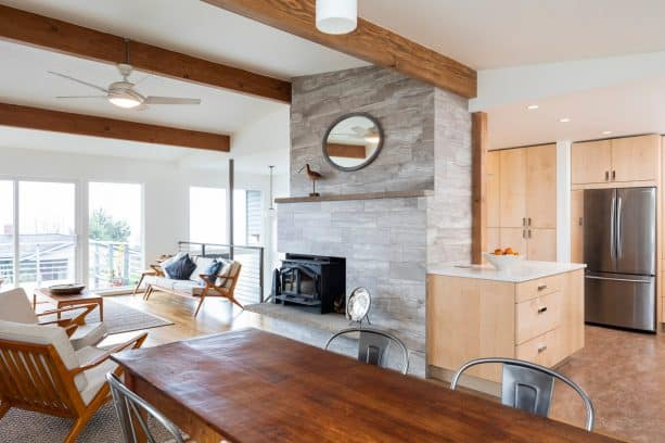 a floor-to-ceiling fireplace concealing a kitchen in a split level house