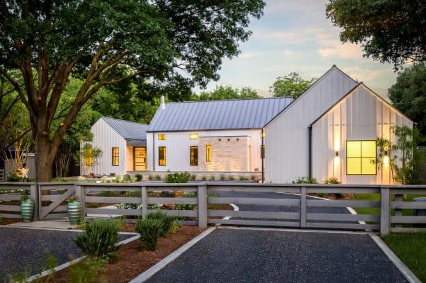 a fabulous modern farmhouse exterior with Agreeable Gray SW 7029 paint color