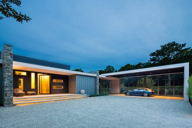 a modern carport with shutters at the back side