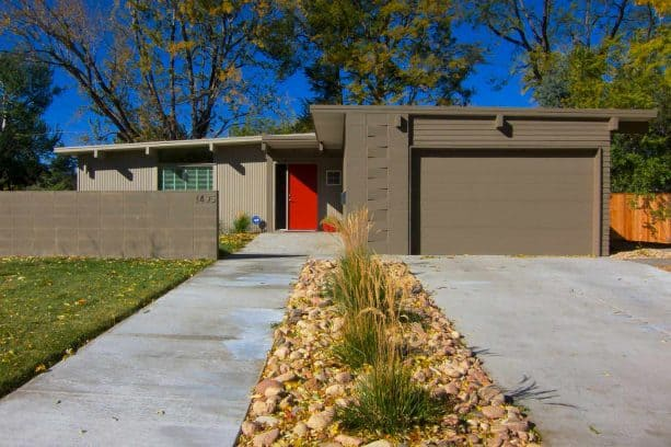 a welcoming exterior with taupe cinder block walls and fence