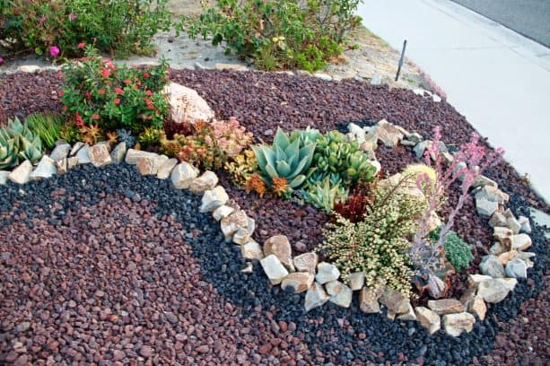 a swirl pattern in a landscape design with black lava and some other rock types
