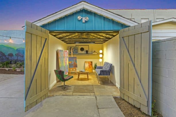 an art studio shed with double-opening, Z-bar style garage door