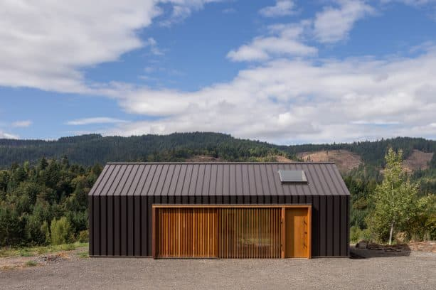 modern charcoal sheet metal tractor shed with very unique wooden sliding door