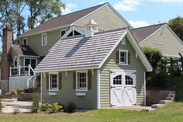 the coordinating taupe exterior between the colonial garden shed and the main house