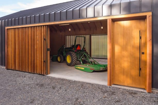the sliding garage entrance is completed with a man door too