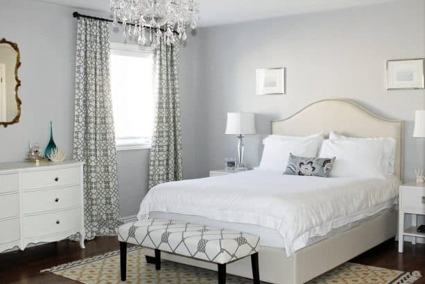 bedroom with grey wall and warm white bed