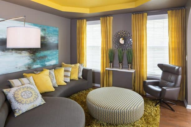 contemporary grey and yellow living room with butter yellow ceiling