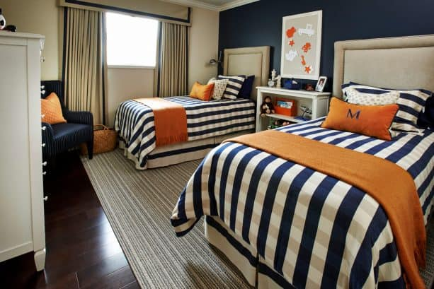 a navy blue bedroom with orange accents