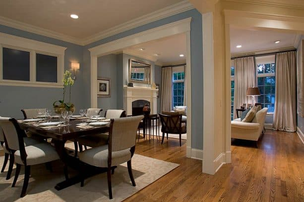 traditional dining room with bluish gray wall and red oak floor