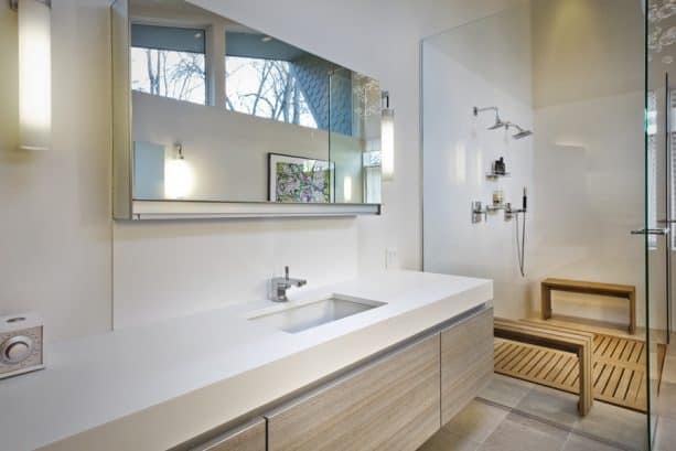 a modern shower room with Glacier White walls