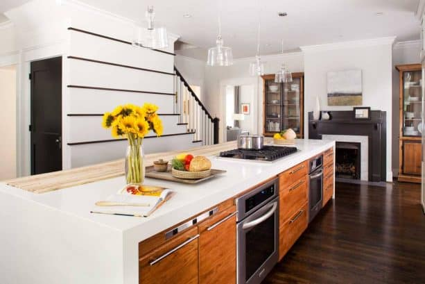 a contemporary kitchen with dark wood floor and custom white island with cabinets