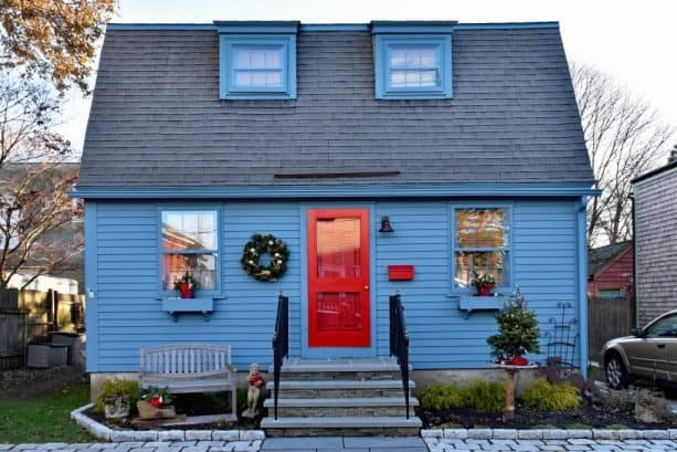 teal blue house with teal blue trim and crimson red door