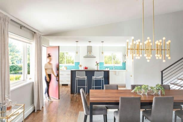 no wall exists to separate the kitchen from the dining and living areas