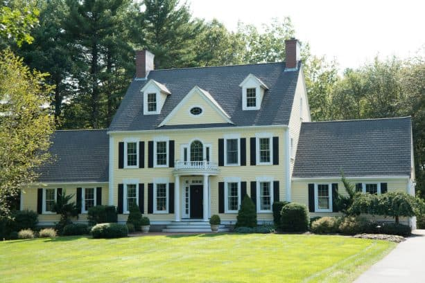 exterior color scheme with pale yellow, white, grey, and black colors